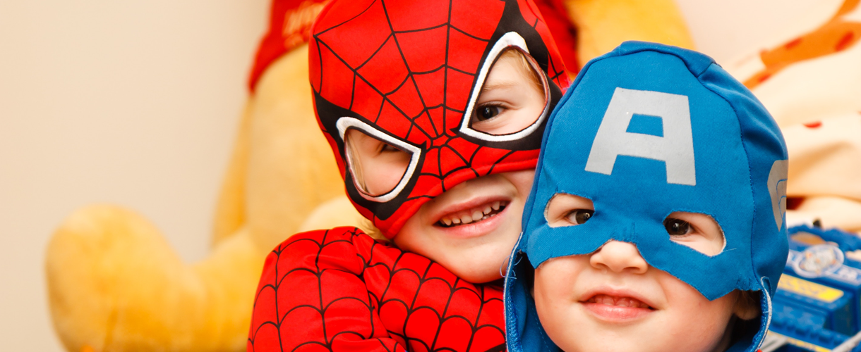 kids in superhero costumes